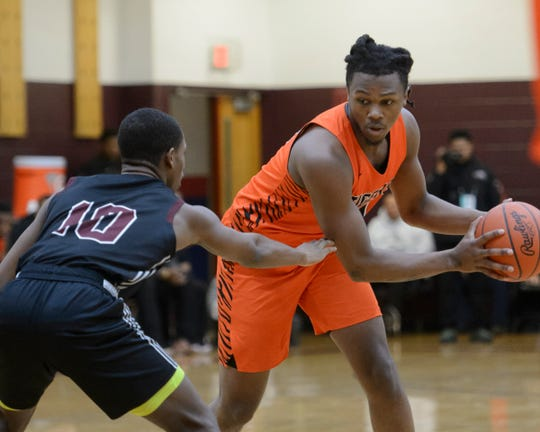 "Benton Harbor's Carlos ""Scooby"" Johnson, plays against River Rouge's Jalen Holly on Saturday, Feb. 22, 2020."