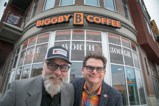 Biggby Coffee Co-CEO Michael McFall, left, poses with Co-CEO Bob Fish outside a Biggby in East Lansing
