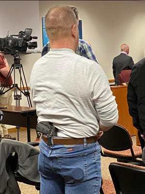 An Allegan County resident stands for the Pledge of Allegiance during the county Board of Commissioners meeting on Thursday, Feb. 27. During the meeting, the board voted unanimously to adopt sanctuary status for the Second Amendment within the county, vowing to not enforce any laws that infringe on residents' rights to bear firearms.