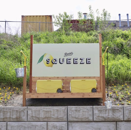 The original Bea's Squeeze on the retaining wall above the bike path near Eastern Market.
