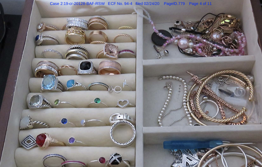 Some of the high end jewelry, sunglasses and watches purchased with money obtained through an adoption scam by Tara Lynn Lee of New Haven.