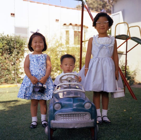 Bob Taenaka at age 2 in the backyard of his home in the Crenshaw District of Los Angeles with his sisters Janet, left, and Patty in 1960. He loved cars from the start.