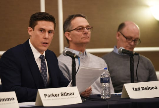 From left, attorney Parker Stinar sits with victims Tad DeLuca and Thomas Evashevski during a press conference. They were among the first men to alert the University of Michigan about alleged abuse by the late Dr. Robert E. Anderson.