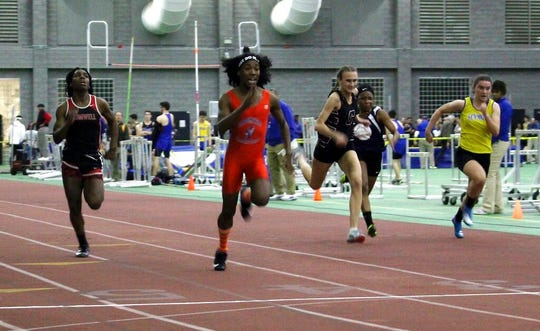 In this Feb. 7, 2019, file photo, Bloomfield High School transgender athlete Terry Miller, second from left, wins the final of the 55-meter dash over transgender athlete Andraya Yearwood, far left, and other runners in the Connecticut girls Class S indoor track meet at Hillhouse High School in New Haven, Conn. Miller and Yearwood are among Connecticut transgender athletes who would be blocked from participating in girls sports under a federal lawsuit filed Wednesday, Feb. 12, 2020, by the families of three athletes.