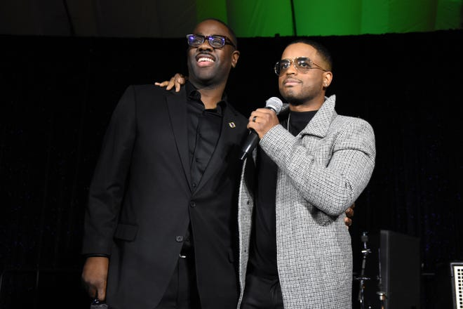 """From left, City Councilman Andre Spivey with """"Power"""" star Larenz Tate."""
