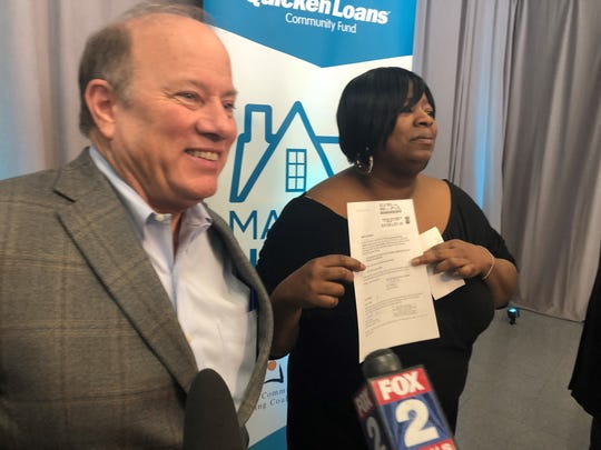 Detroit Mayor Mike Duggan was with Roshona Kennedy on Thursday, Feb. 27, 2020 as the 40-year-old Detroiter received the deed to her grandparents' house that she almost lost to tax foreclosure.