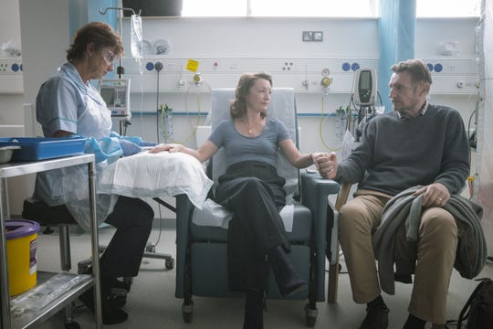 """Lesley Manville (center) and Liam Neeson (right) in """"Ordinary Love."""""""