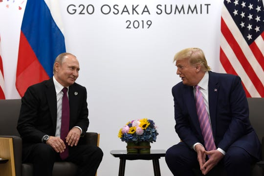 President Donald Trump, right, meets with Russian President Vladimir Putin during a bilateral meeting June 28, 2019, on the sidelines of the G-20 summit in Osaka, Japan.