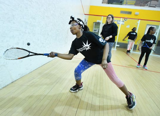 Kiana Simpson, 10, hits a shot while on the squash court with instructor Emma Head as part of the Racquet Up Detroit program at the Northwest Activities Center in Detroit.