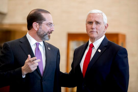 Vice President Mike Pence and Health and Human Services Secretary Alex Azar speak as Pence arrives for a coronavirus task force meeting at the Department of Health and Human Services, Thursday, Feb. 27, 2020, in Washington.