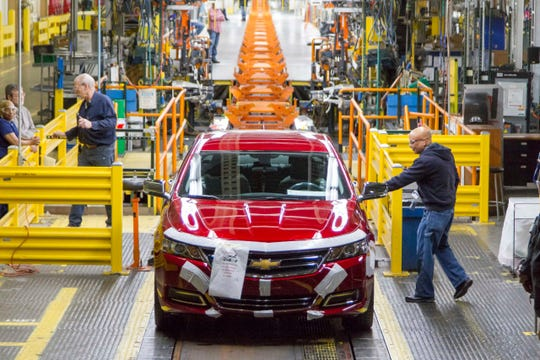 The last Chevrolet Impala comes off the production line at the Detroit-Hamtramck Assembly plant on Thursday. The plant will be completely devoted to electric vehicle production by the fall of 2021.