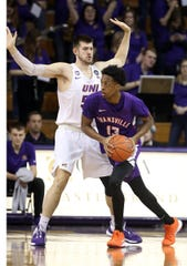 Northern Iowa's Austin Phyfe guards Evansville's Deandre Williams during action at the McLeod Center in Cedar Falls, Iowa, Wednesday, Feb. 26, 2020.