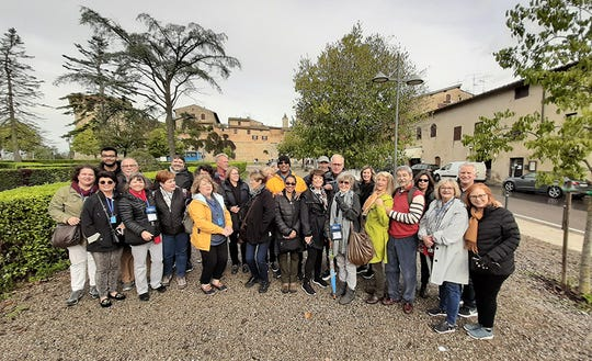 A group of travelers in Tuscany during a past Chamber Travelers event.