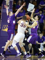 Evansville's Evan Kuhlman, left, and Sam Cunliffe pressure Northern Iowa's Noah Carter under the basket during action at the McLeod Center in Cedar Falls, Iowa, Wednesday, Feb. 26, 2020.
