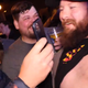 Standup comedian Bert Kreischer (left) laughs with a fan after he autographed the man's chest following a performance at Evansville's Old National Events Plaza on Feb. 22.
