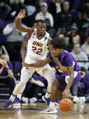 Northern Iowa's Antwan Kimmons guards Evansville's Shamar Givance during action at the McLeod Center in Cedar Falls, Iowa, Wednesday, Feb. 26, 2020.