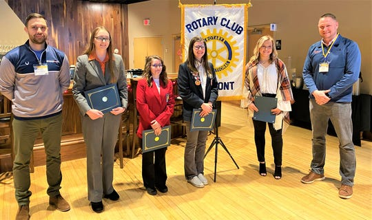 Left to right are Cody Bischoff, Fremont Rotary Club President-Elect, and students of the month,  Kortini Joseph, Haily Hill, Madelyn Wammes, and  Isabelle Held and Roger Kuns, Fremont Rotary Club President.