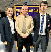 Students Hannah Holman, left, and Noah Lindenberger, right, stand with St. Joseph Principal Mike Gabel.