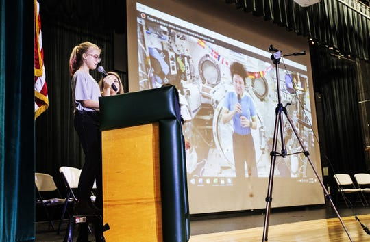 Abigail Mitchell, a 6th grader at Trafalgar Middle School asks a question of NASA astronaut, Jessica Meir at Fort Myers High School on Thursday Feb. 27, 2020. Almost 20 Students from Lee County schools got to take part in a Q & A session with the astronaut who is on the International Space Station.