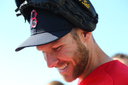 Boston Red Sox starting pitcher Chris Sale smiles as he works out prior to the spring training game against the Tampa Bay Rays at JetBlue Park.