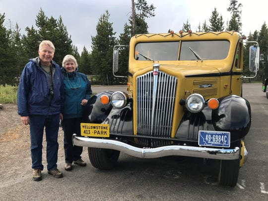 Carl and Lynn Rasmussen pose with a 1937 tour bus at Yellowstone National Park in 2018. They stopped there as part of a cross-country tour to re-create the 6,500-mile honeymoon trip of Carl's parents in 1937. The Stevens Point couple  will discuss their trip on March 12 at a meeting of the Oconto County Historical Society.