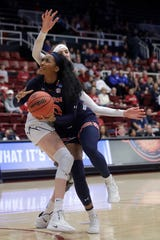 Auburn forward Unique Thompson, foreground, drives against BYU center Sara Hamson during the second half of a first-round game in the NCAA women's college basketball tournament in Stanford, Calif., Saturday, March 23, 2019. (AP Photo/Jeff Chiu)