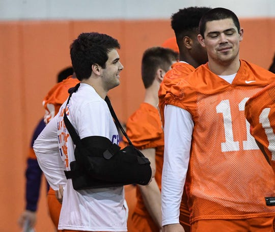 Clemson safety Nolan Turner(24), left, wears an arm sling near  defensive lineman Bryan Bresee(11) during Spring practice in Clemson Wednesday, February 26, 2020.