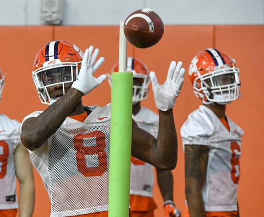 Clemson wide receiver Justyn Ross(8) catches a ball near  wide receiver E.J. Williams(6) during Spring practice in Clemson Wednesday, February 26, 2020.