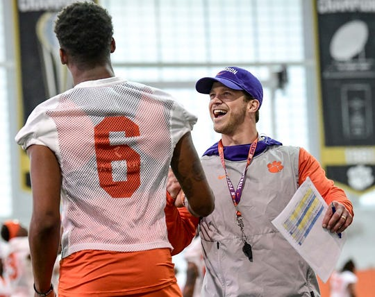 Clemson wide receivers coach Tyler Grisham smiles with  wide receiver E.J. Williams(6) during Spring practice in Clemson Wednesday, February 26, 2020.