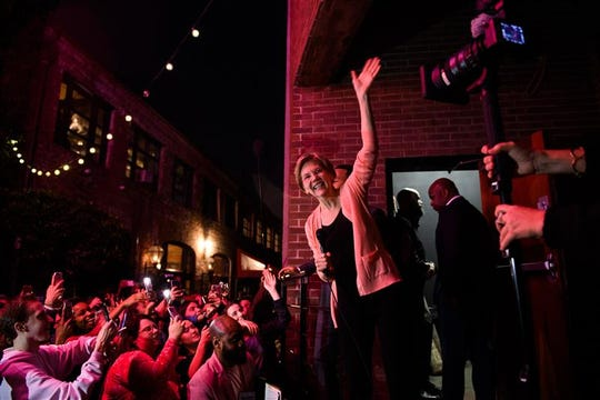 Sen. Elizabeth Warren greets several hundred supporters who watched her event with musician John Legend from outside the packed Charleston Music Hall Wednesday night.