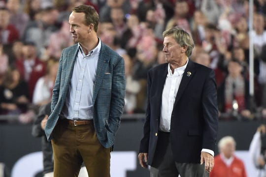 Jan 9, 2017; Tampa, FL, USA; Peyton Manning and Steve Spurrier on the field prior to the game between the Alabama Crimson Tide and the Clemson Tigers in the 2017 College Football Playoff National Championship Game at Raymond James Stadium.