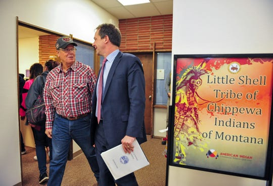 Clarence Sivertsen, left, a tribal councilman of the Little Shell Tribe of Chippewa Indians, welcomes Gov. Steve Bullock to the tribal office in Great Falls on Thursday for a talk on the 2020 Census.