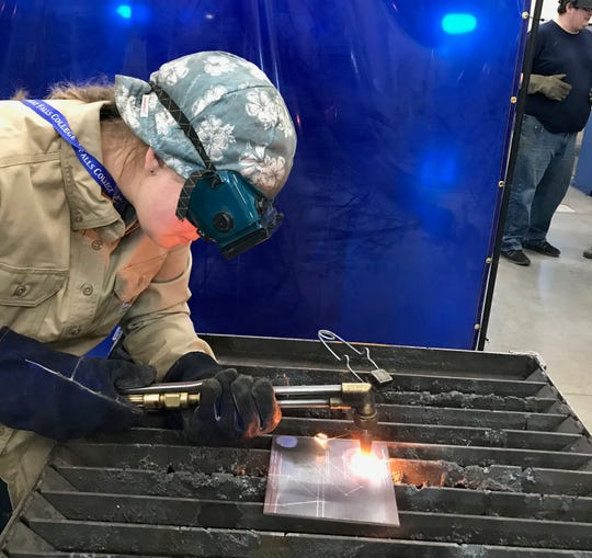"""Sophomore Zoe Belinda of Red Lodge was the only girl in the welding competition at Great Falls College on Thursday, but she said it is not intimidating even though she does not have as much experience in the shop as many of her male counterparts. """"I'm having fun, and that's what's important,"""" she said."""