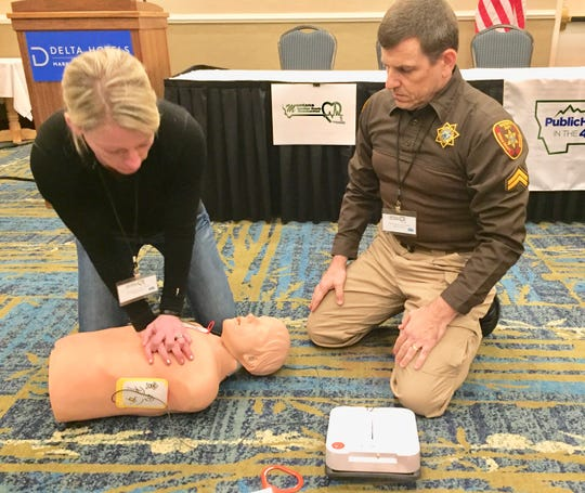 Sheridan County Sheriff Heidi Visocan and Kirby Dempster of the Fergus County Sheriff's Office demonstrate the new Automatic External Defibrillators.
