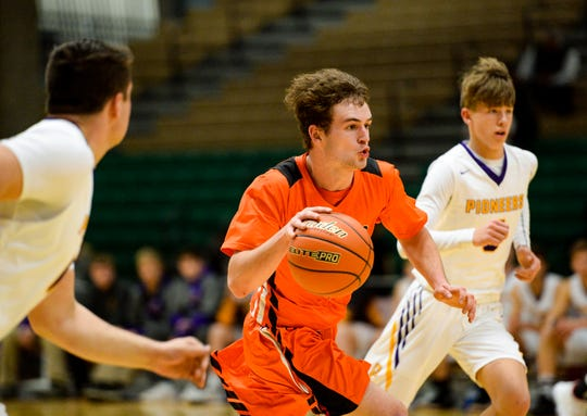 Centerville's Carson McGinness pushes the ball up the floor during Wednesday's game against Big Sandy at the Northern C Divisional Basketball Tournament in the Four Seasons Arena.