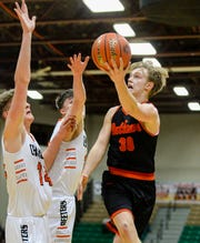 Roy-Winifred's Tyler Fordyce attempts a layup during Thrusday's game against Chinook at the Northern C Divisional Basketball Tournament in the Four Seasons Arena.