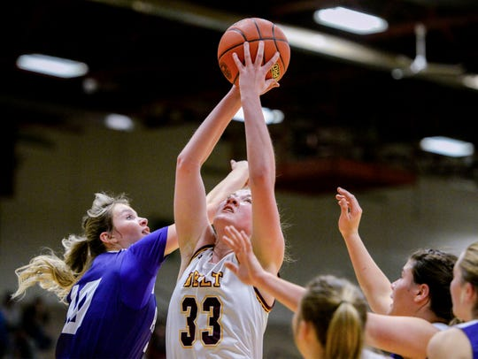 Belt's Abby Gliko grabs an offensive rebound in front of Valier's Erica Ramsey during the Northern C Divisional Basketball Tournament in the Four Seasons Arena.