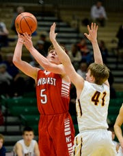 Sunburst's Jaden Koon attempts a shot over Belt's Keaghan McDaniel during the Northern C Divisional Basketball Tournament in the Four Seasons Arena on Wednesday.