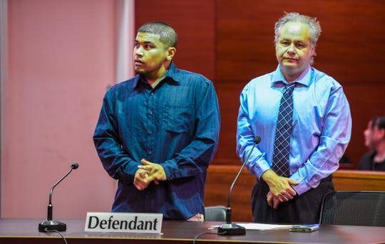 Defendant Brandon Acosta, left, cracks his knuckles as he and his attorney, William Pole, wait for jurors to enter the courtroom for what was to be the first day of his trial at the Guam Judicial Center on Hagåtña on Feb. 27, 2020. Acosta is accused of sexually assaulting and murdering 15-year-old Timicca Nauta in her bedroom on Chalan Koda in Dededo in 2018. The start of the trial was delayed due to Guam prosecutor Lenny Rapadas falling ill before the proceedings.