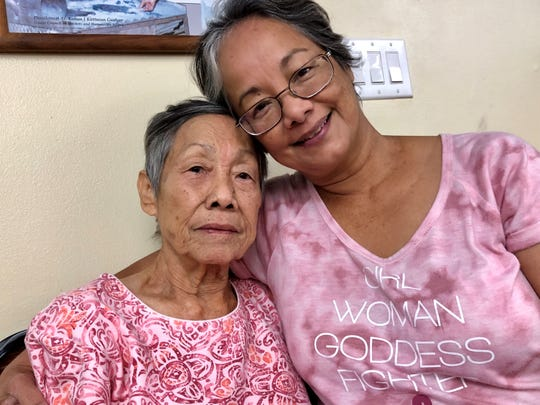 World War II survivor Josefa A. Acfalle, 82, and her daughter Connie San Nicolas share their family's history and experiences during the war. Nearly 76 years after the war ended, Acfalle received an advance war claims payment on Feb. 27, 2020 under a GovGuam program.