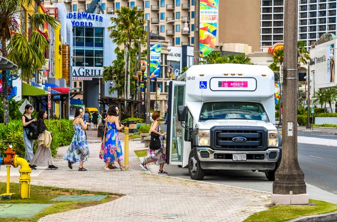 Tourists prepare to board a shuttle bus, near the Pleasure Island district of Tumon in this Feb. 27 file photo. GVB cannabis in Tumon could result in significant drops in tourist arrivals, resulting in a net loss of $486 million.