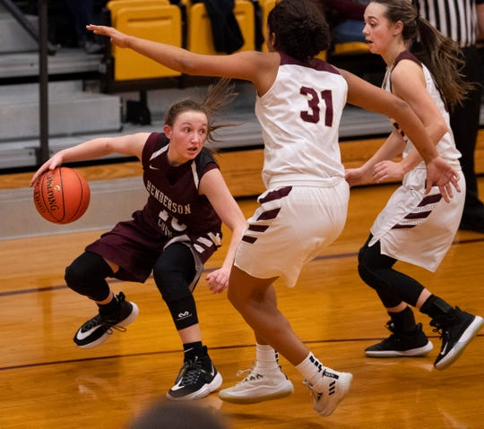 Henderson County's Sadie Wurth (15) looks for an opening against Webster County's Raigan Price (31) and Webster County's Madison Hinton (12) during the Sixth District Tournament girls finals at Webster High School in Dixon, Ky., Wednesday night.