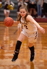 Webster County's Marissa Austin (2) drives toward the basket against Henderson County during the Sixth District Tournament girls finals at Webster High School in Dixon, Ky., Wednesday night.