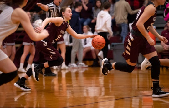 Henderson County's Sadie Wurth (15) dribbles up court against Webster County during the Sixth District Tournament girls finals at Webster High School in Dixon, Ky., Wednesday night.