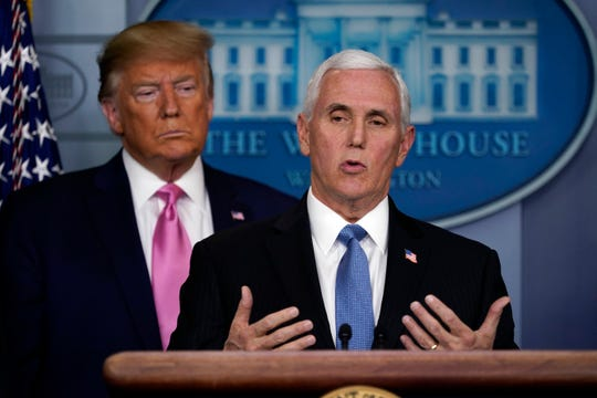 President Donald Trump listens as Vice President Mike Pence speaks during a news conference about coronavirus in the Brady Press Briefing Room of the White House, Wednesday, Feb. 26, 2020.