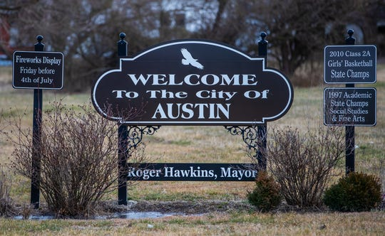 A welcome sign sits along West Main Street in Austin, Ind., on Thursday, Feb. 27, 2020.