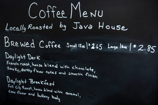 A coffee menu lists Java House roasts at Daylight Donuts during a soft opening, Thursday, Feb. 27, 2020, at 1681 S. 1st Avenue in Iowa City, Iowa.