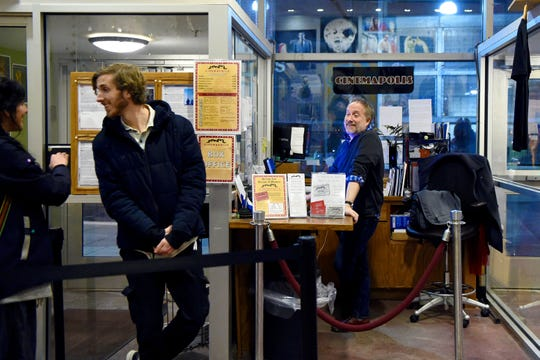 Brett Bossard, Executive Director of Cinemapolis, right, at the theater's box office in downtown Ithaca. Cinemapolis started in 1986 and became a not-for-profit in 2000. The five-screen movie theater specializes in independent, foreign, and locally-produced films.