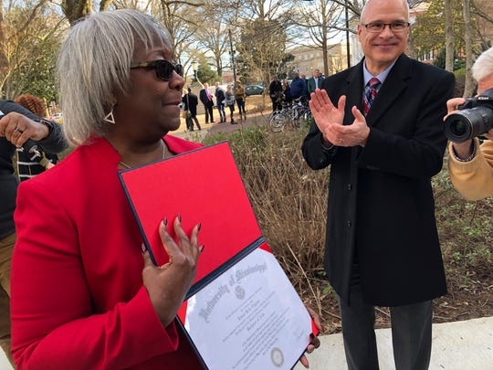 Linnie Liggins Willis shows off her 1970 University of Mississippi diploma that she received from the university's provost, Noel Wilkin, on Tuesday, Feb. 25, 2020, on the Ole Miss campus in Oxford, Miss. She was among the eight University of Mississippi students who were suspended from the university for protesting racial inequality in February 1970. Although she had completed her academic requirements to earn the diploma, the university did not award it at the time. The eight suspended students were among 89 African Americans arrested during the protests. (AP Photo / Brittany M. Brown)