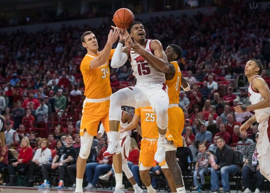Feb 26, 2020; Fayetteville, Arkansas, USA; Arkansas Razorbacks guard Mason Jones (15) goes up for a shot and is fouled by Tennessee Volunteers forward Uros Plavsic (34) during the first half of the game at Bud Walton Arena. Mandatory Credit: Brett Rojo-USA TODAY Sports